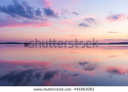 Floating sauna in a colourful sunset looking as part of an oil painting on Saadjarv in Estonia. - stock photo