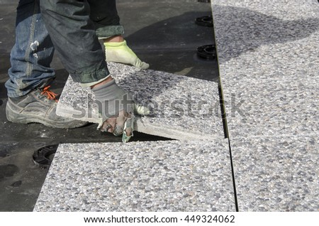 Floating tile on a building site with thread for alignment - stock photo