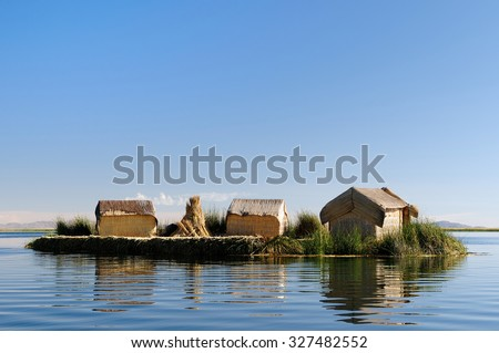 Floating Uros islands on the Titicaca lake, the largest highaltitude lake in the world (3808m). Theyre built using the buoyant totora reeds that grow abundantly in the shallows of the lake, Peru - stock photo