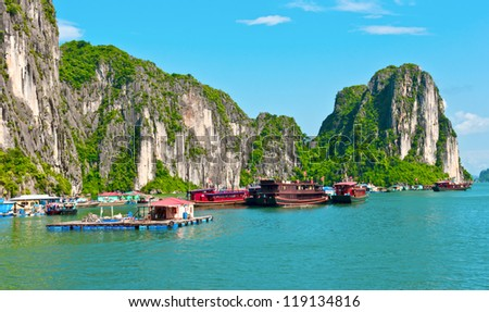 Floating village and boats in Halong Bay, Vietnam, Southeast Asia - stock photo