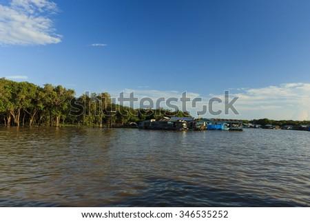 Floating village at Cambodia - stock photo