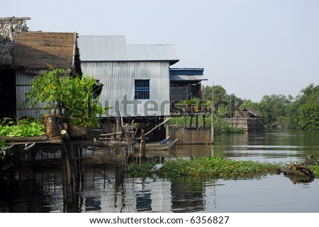Floating village houses, Tonle Sap, Cambodia - stock photo