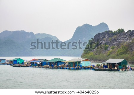 Floating village in Ha Long Bay near Cat Ba Island, Hai Phong Province, Vietnam