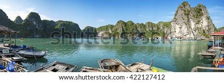 Floating village  Surrounded by limestone islands in Bai Tu Long Bay, near Ha Long Bay, northern Vietnam. - stock photo