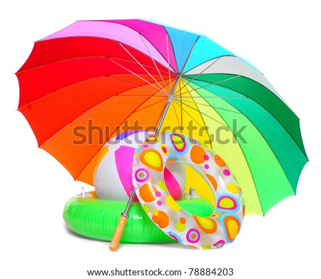 Floating water toys and beach umbrella isolated on white background - stock photo