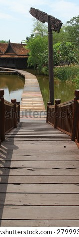 Floating wooden bridge - stock photo