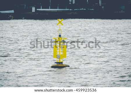 Floating yellow navigational buoy on River (Vintage Style)