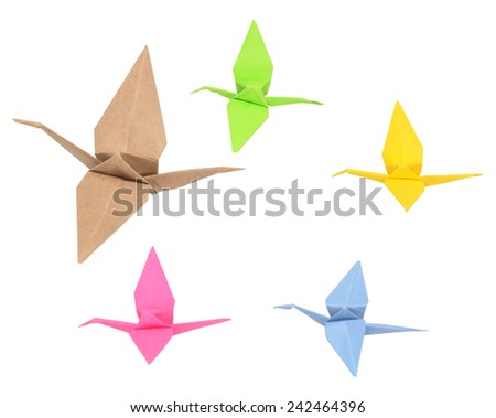 flock of origami birds on white - stock photo