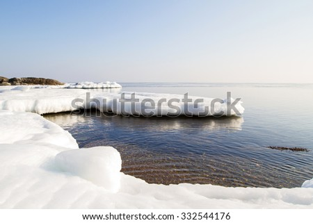 Floe, icy shore of the sea. North sea, the cold sea of the North, winter ice, white snow of the Arctic, Arctic ocean, beautiful winter nature. Beach at the winter ocean. Spring Arctic. Melting of ice - stock photo
