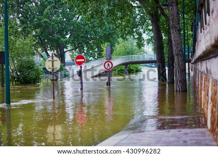 Flood in Paris, extremely high water on the river Seine, road signs covered with water