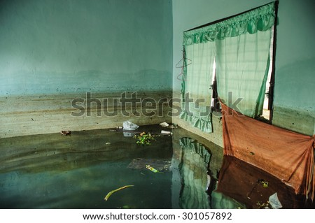 Flood Natural Disaster - Old Living Room Destroyed From Flood, Thailand - stock photo