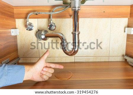 flood  under drain of sink in bathroom - stock photo