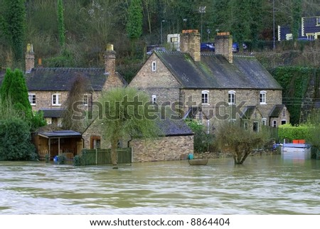 Flood water in the Ironbridge Gorge Shropshire, England - stock photo