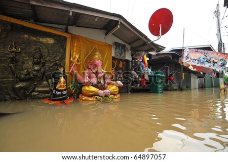 flood waters overtake a house in Thailand - stock photo
