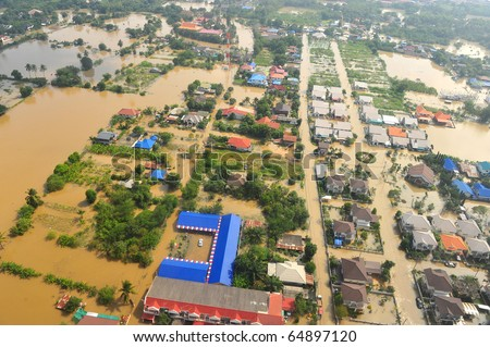 flood waters overtake a house in Thailand form above view - stock photo