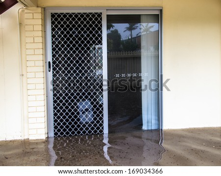 Flood waters running through a screen door - stock photo