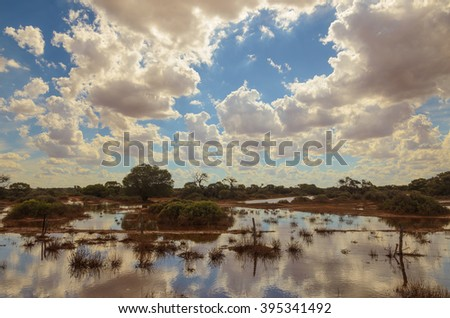 Flooded Australian outback remote area natural disaster - stock photo