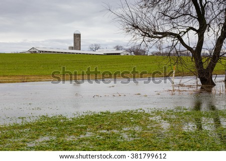 Flooded farmland next to dairy farm