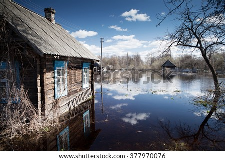Flooded home and plots of land in the villages during the spring flood of the river Pripyat - stock photo
