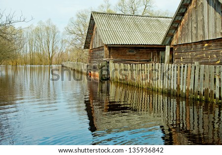 Flooded homes and plots of land in the villages during the spring flood of the river Pripyat - stock photo