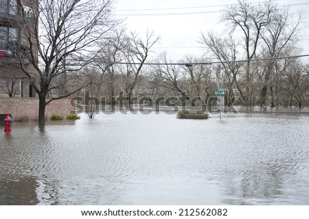 Flooded homes in the Chicago area on a cloudy day. - stock photo