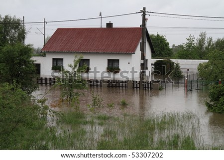 Flooded house in north-east of Czech republic. Name of the village - Detmarovice. - stock photo