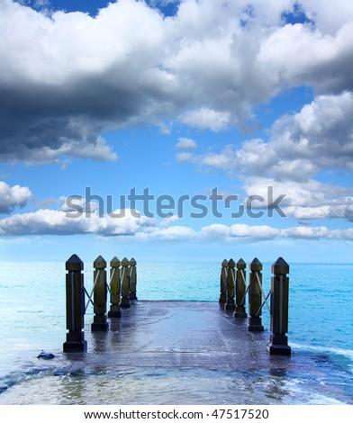 Flooded jetty - stock photo