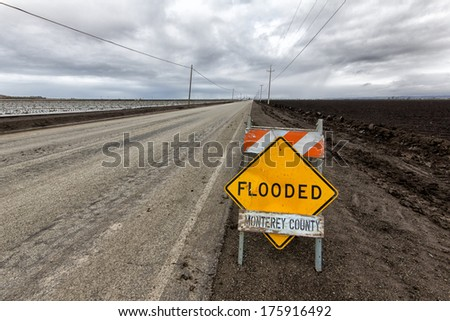 Flooded Roadway Sign in Monterey County, California - stock photo