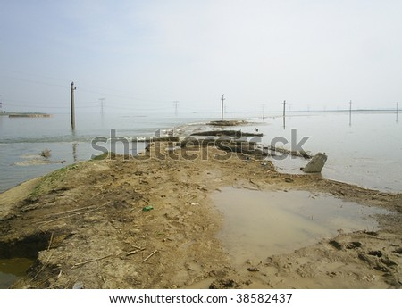 Flooded rural area water invading the fields - stock photo