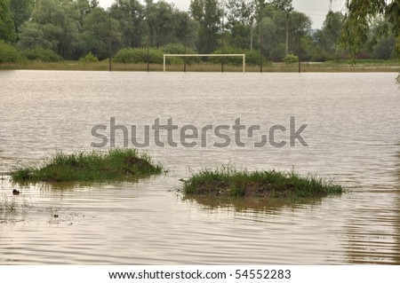 flooded soccer pitch - stock photo