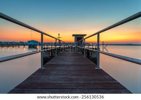Floodgate in sunset  - stock photo