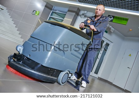 Floor care and cleaning services with washing machine in business centre hall - stock photo