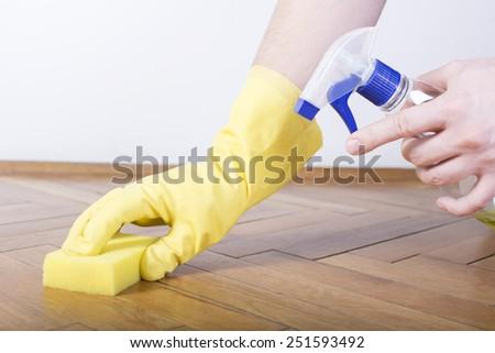 Floor cleaning, sponge, gloves and sprayer - stock photo