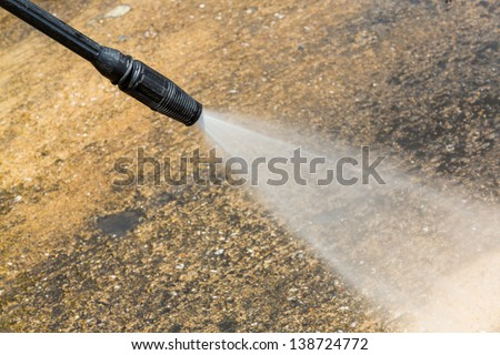 Floor cleaning with high pressure water jet - stock photo