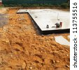 Floor foundation surrounded by soil for new house. - stock photo