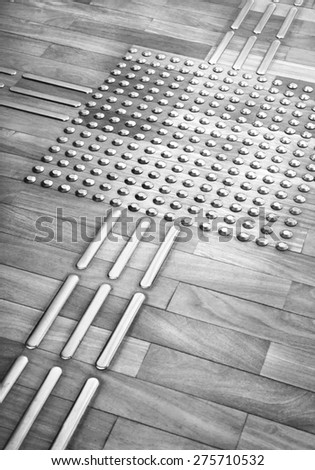 floor with orientation in braille signs - Metro platform accessibility - stock photo