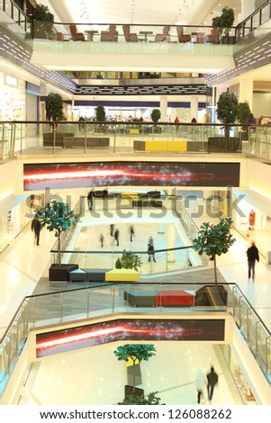 floors in mall with people in motion - stock photo