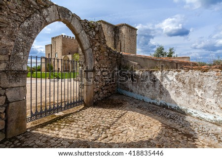 Flor da Rosa Monastery in Crato seen through the gothic gate. Belonged to the Hospitaller Knights (aka Malta Order), a Crusader Order. Currently a Pousada de Portugal / Historical Inn of Portugal. - stock photo