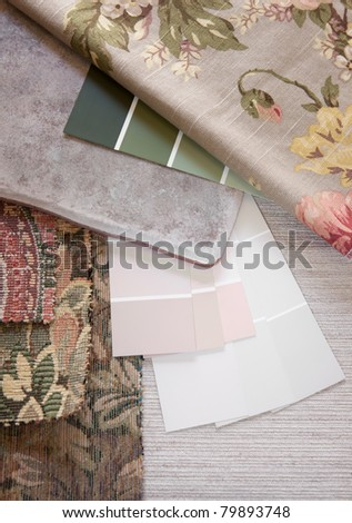 Floral and pastel paint color and fabric swatches with a floor tile - stock photo