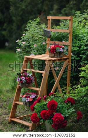 floral arrangement in the garden on a wooden staircase bright beautiful bouquet