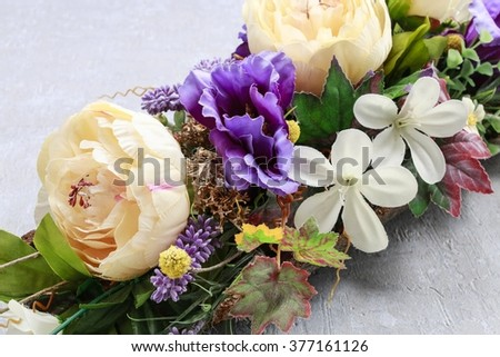 Floral arrangement with artificial flowers - stock photo