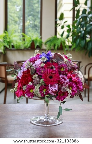 Floral arrangement with gerbera, carnation, chrysanthemum and delphinium flowers