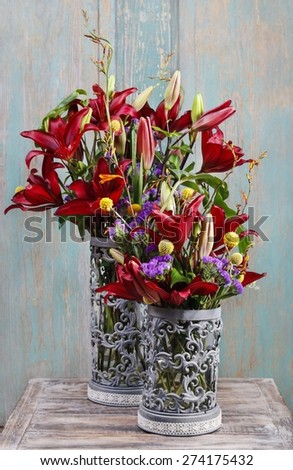 Floral arrangement with red lilies - stock photo