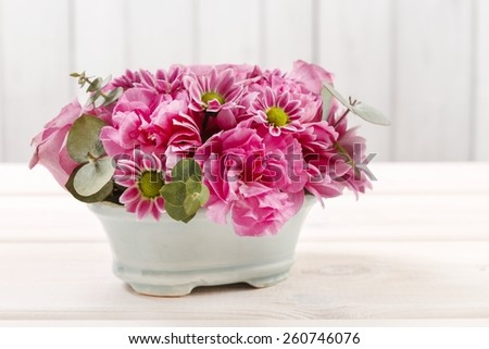 Floral arrangement with rose, carnation and chrysanthemum flowers - stock photo