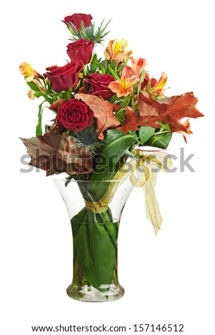 Floral bouquet of roses and lilies arrangement centerpiece in vase isolated on white background. Closeup. - stock photo