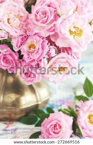 Floral composition with a pink  roses in a vintage jug . Pink flowers. - stock photo