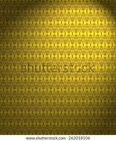 Floral Damask Wallpaper Pattern in yellow with a spotlight - stock photo