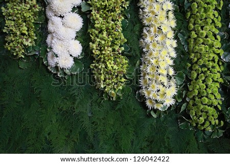 Floral decoration on grass backdrop - stock photo