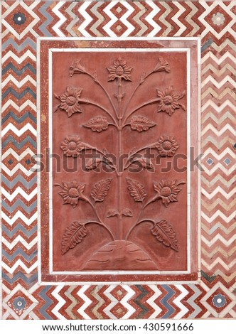 Floral designs carved on the sandstone wall in Taj Mahal complex