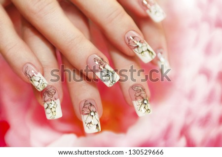 Floral French manicure on the pink white background. - stock photo